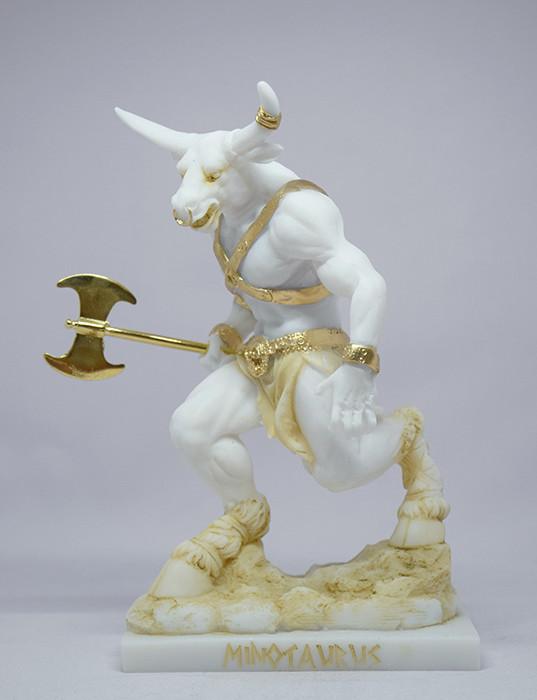 Τhe Minotaur statue holding a double-edged axe in Patina color
