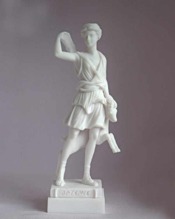 The statue of Artemis holding her bow, quiver and a young deer in White color