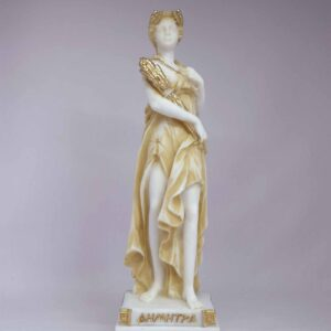 The statue of Demeter standing and holding wheat in Patina color