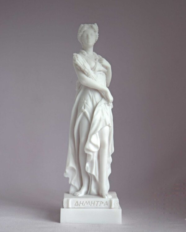 The statue of Demeter standing and holding wheat in White color