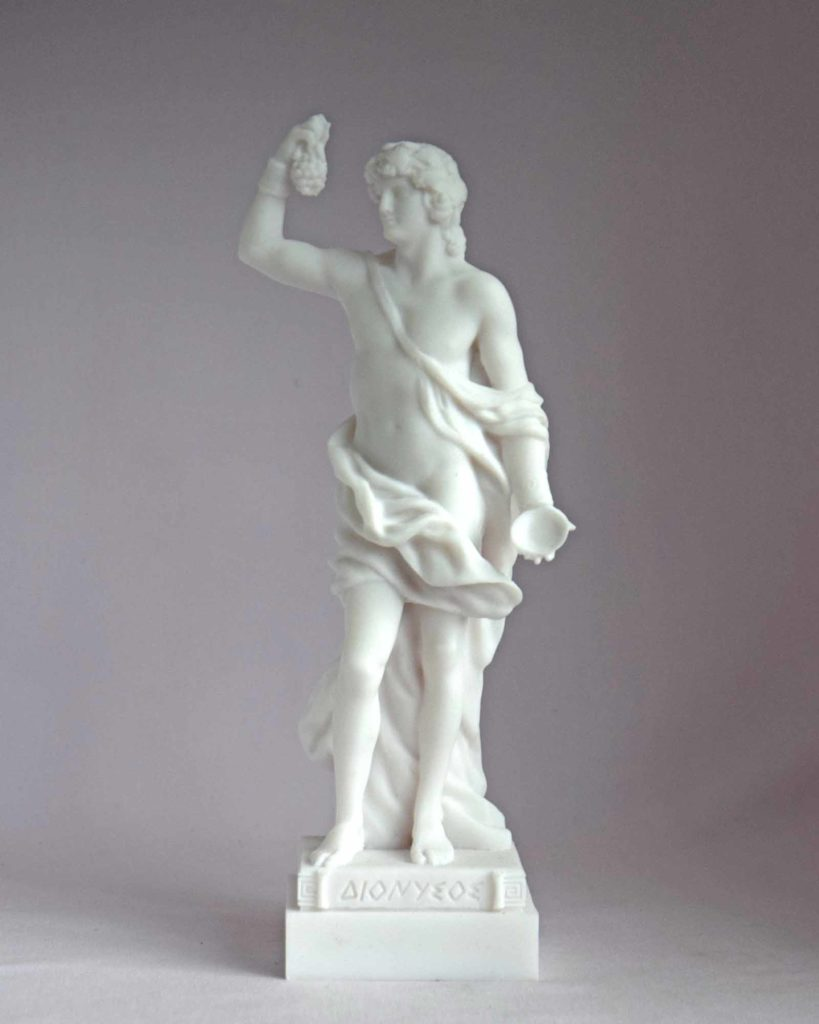The statue of Dionysus holding a bunch of grapes and a container in White color.