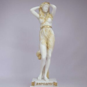 The Statue of Aphrodite stands and holds her head with both her hands in Patina color