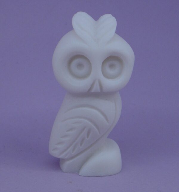 A micrography statue of a small Owl in White color