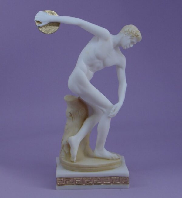 The statue of Discobolus (Discus thrower) ready to throw the discus in Patina color