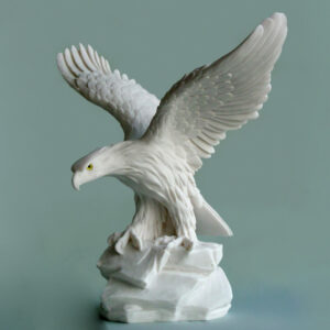 The statue of an Eagle taking off in White color