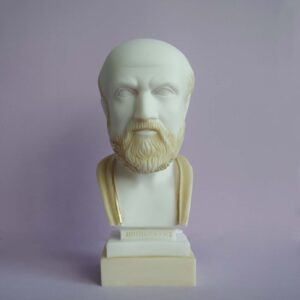 The bust statue of Hippocrates made of Alabaster in Patina color