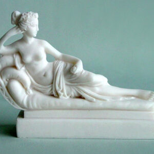 A replica statue of Paolina Borghese made by Canova in White color