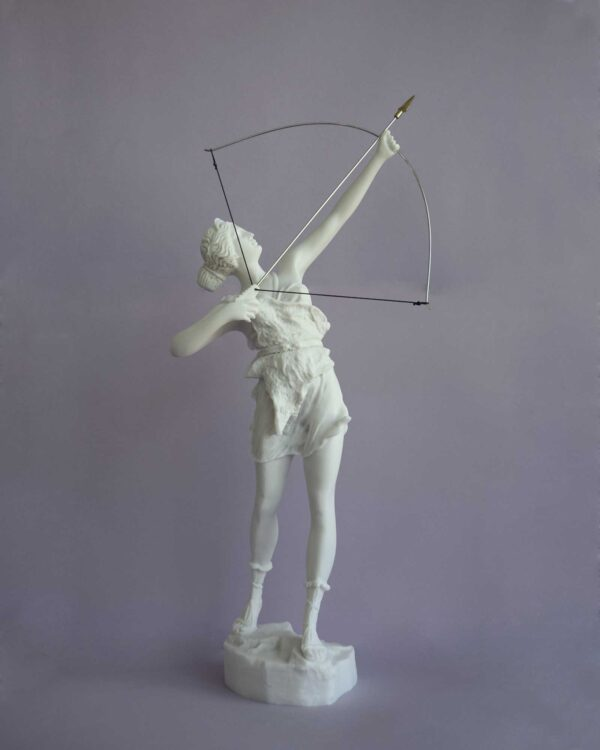 The statue of Greek Goddess Artemis hunting, ready to shoot with bow in White color