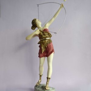 The statue of Greek Goddess Artemis hunting, ready to shoot with bow in color