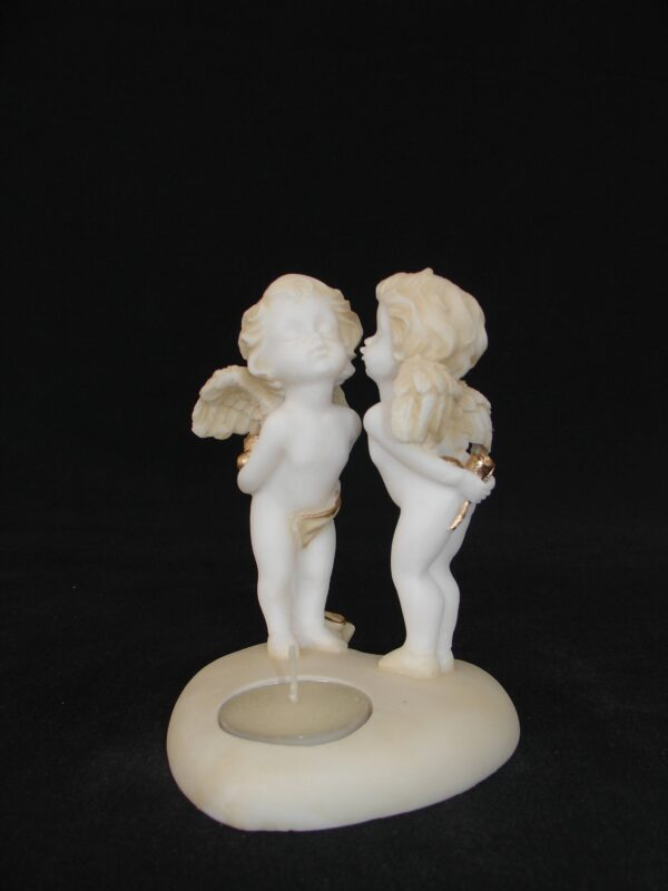 A statue of two Angels standing on a heart shape candle type 3 in Patina color