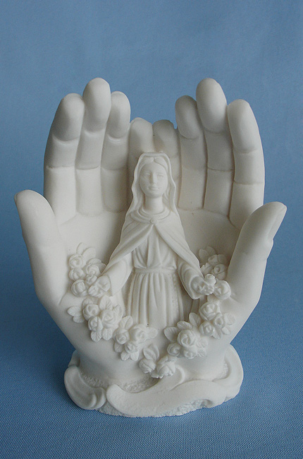 The statue of Virgin Mary inside hands in White color