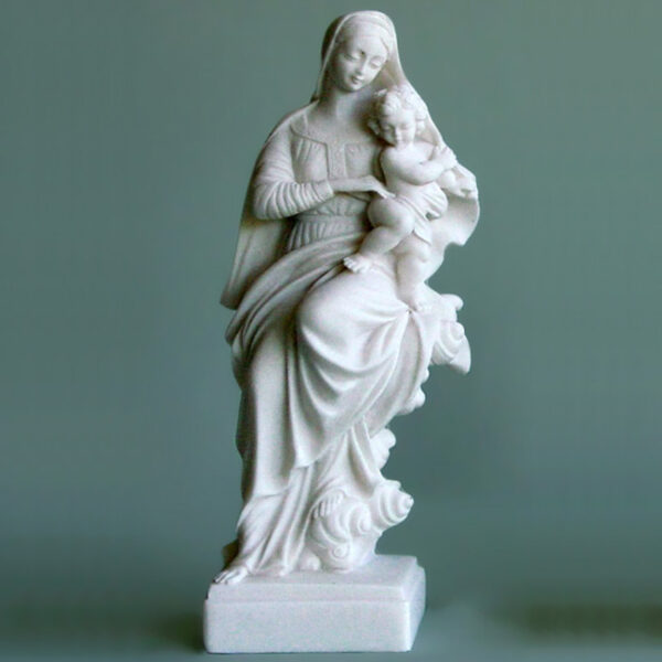 The statue of Mary embracing the baby Jesus in her arms in White color