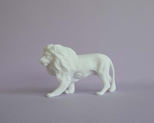 The statue of a Lion walking in White color