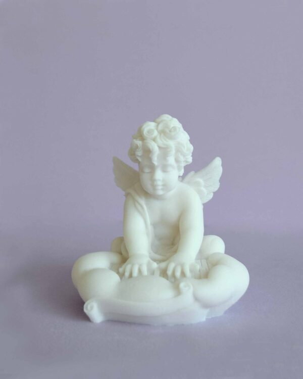 A statue of an Angel playing the piano in White color