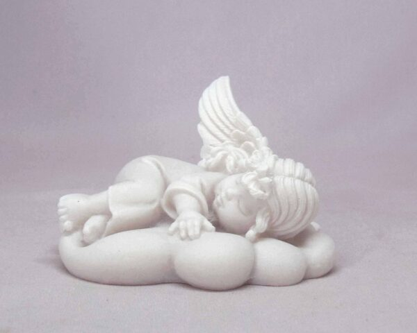 The statue of an Angel sleeps on a cloud in White color
