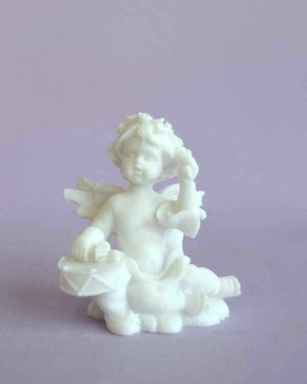 A statue of an Angel playing his drums in White color