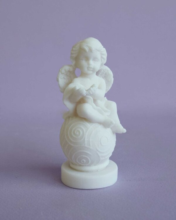 A statue of an Angel sitting on a sphere type 4 in White color