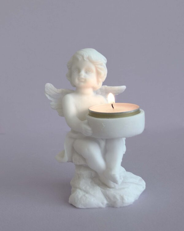 A statue of an Angel holding a candle in White color