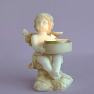 A statue of an Angel holding a candle in Patina color