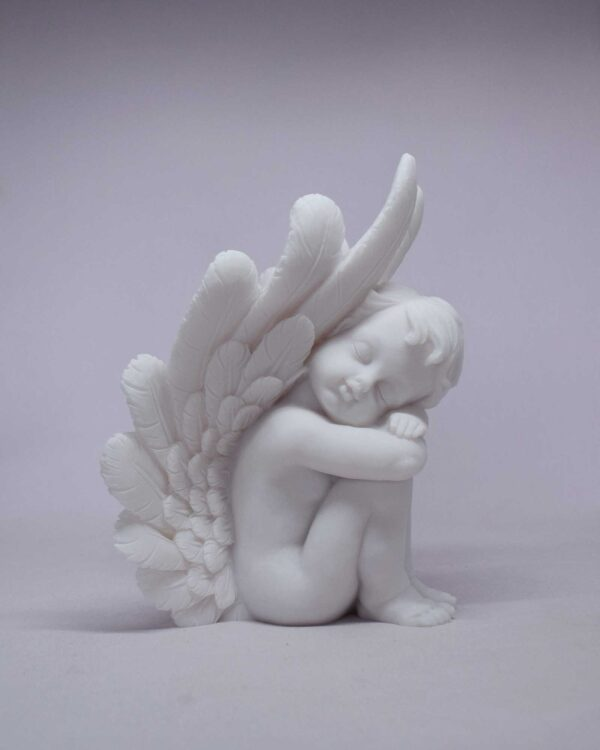 A statue of an Angel used for bookend at right side in White color