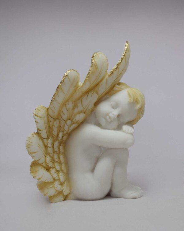 A statue of an Angel may used for bookend at right side in Patina color