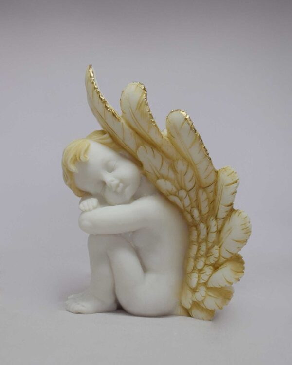 A statue of an Angel may used for bookend at left side in Patina color