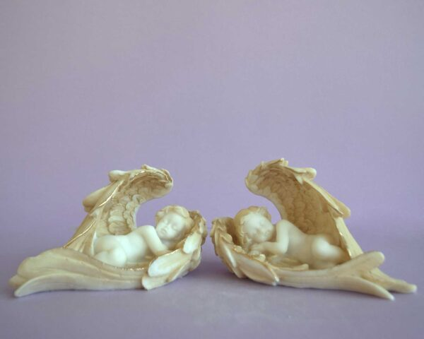 Statue of an Angels sleeping in their wings in Patina color