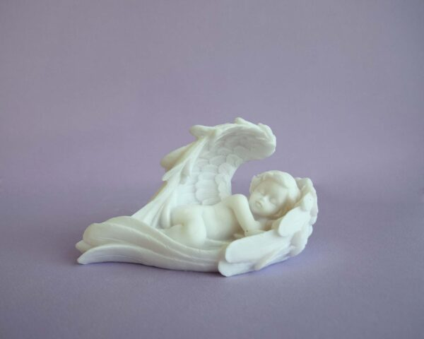 A statue of an Angel sleeping in its wings (right view) in White color
