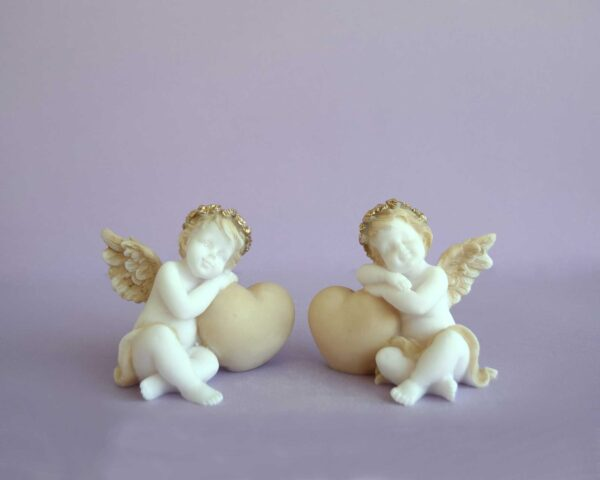 Statues of Angels hugs a heart