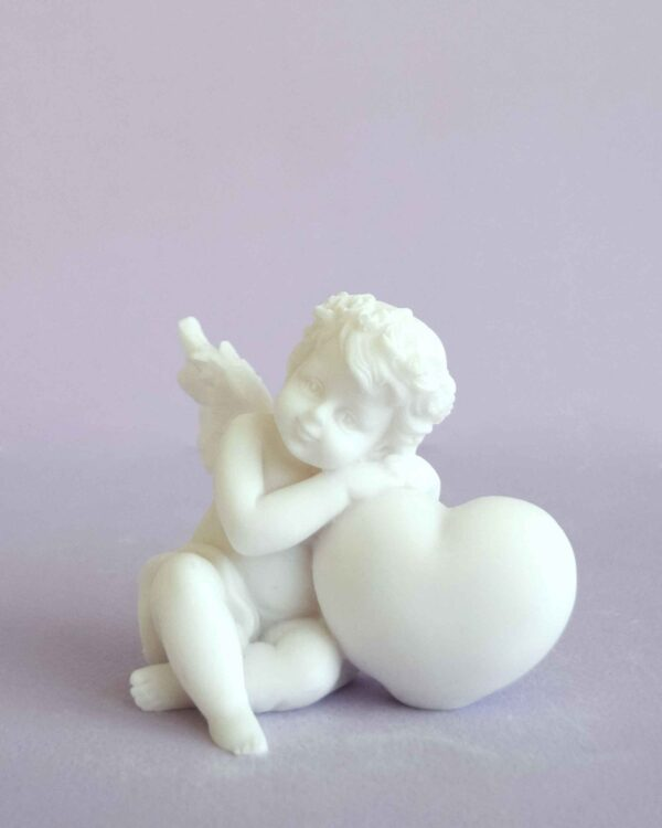 A statue of an Angel hugs a heart right view in White color