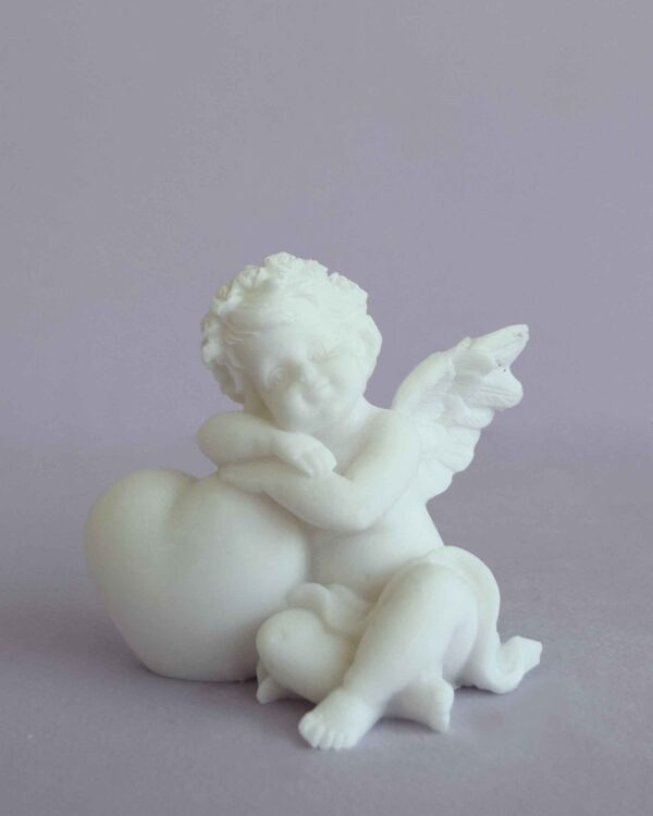 A statue of an Angel hugs a heart left view in White color