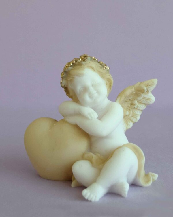 A statue of an Angel hugs a heart left view in Patina color