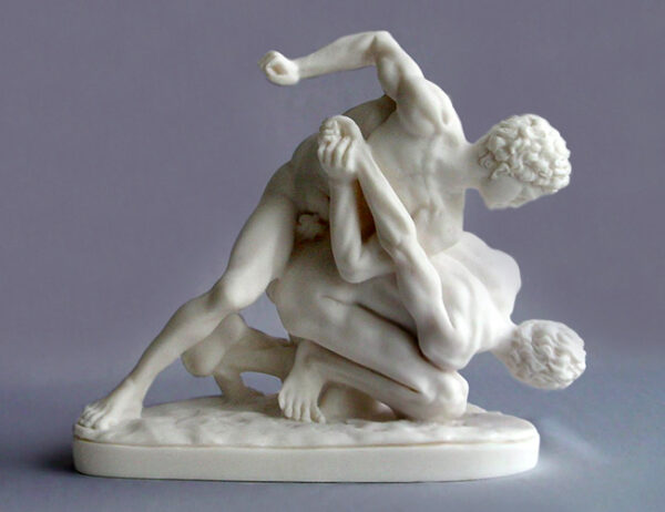 A statue of two men illustrates Greek Ancient wrestling in White color
