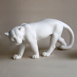 The statue of a Puma walking in White color