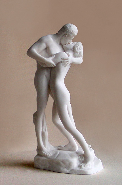 The statue of a couple kissing each other in a very sensual way in White color