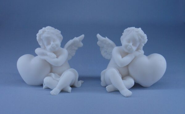 Statues set of Angels hugs a heart