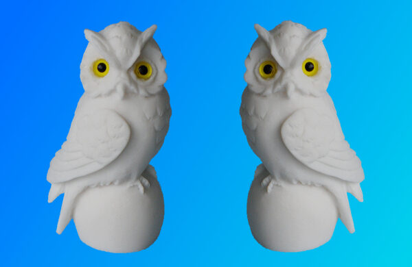 Owls sitting on a sphere in White color