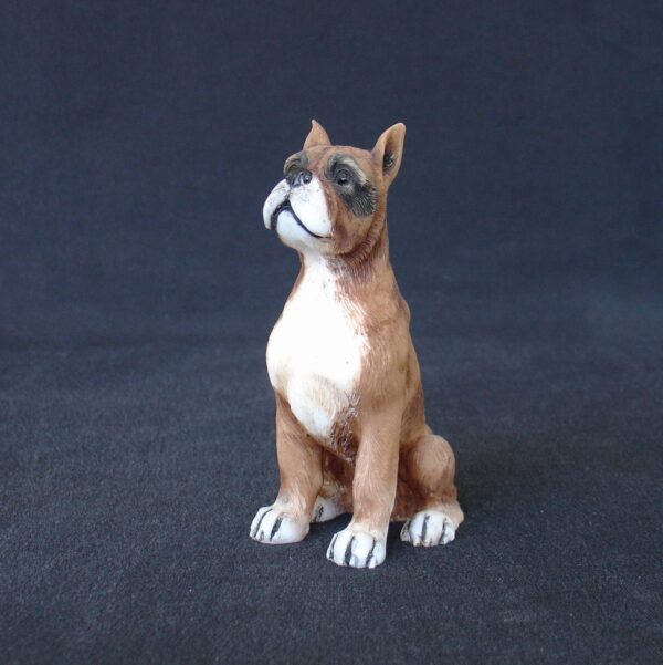 Greek statue of a Boxer pet dog statue sitting on the floor