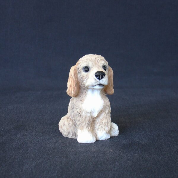 Greek statue of a Poodle pet dog statue sitting on the floor