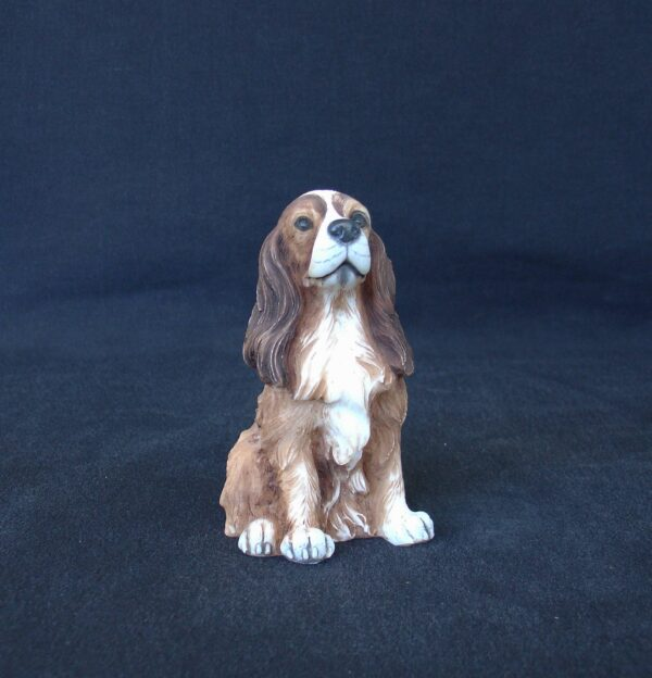 Coker Spaniel pet dog statue sitting on the floor made of alabaster