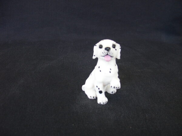 Greek statue of a Dalmatian baby pet dog statue sitting on the floor