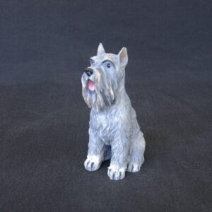 Schnauzer pet dog statue sitting on the floor