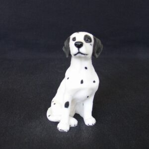 Greek statue of a Dalmatian pet dog statue sitting on the floor