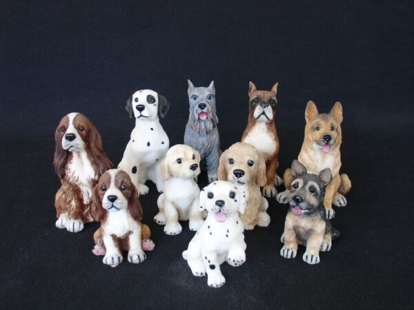 Various dogs sitting on the floor made of alabaster