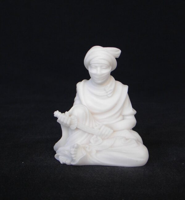 Greek statue of Arab man holding knife while sitting down in White color