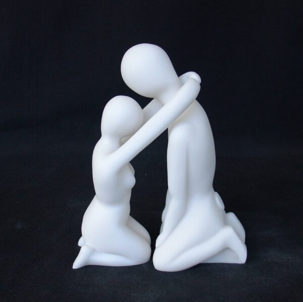 The statue of a couple depicted in modern style in White color