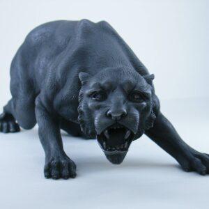 Greek statue of a Jaguar that roars